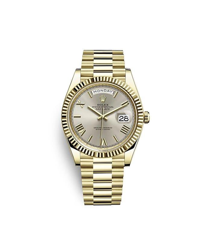 นาฬิกา Rolex Day-Date 40 มม., ทองคำ หน้าปัดสีเงิน ขอบหน้าปัดแบบเซาะร่อง